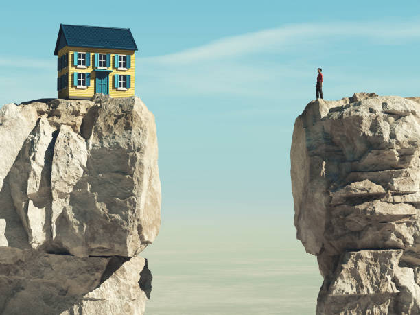 Man looks to a house over a gap between two mountain peaks. This is a 3d render illustration stock photo