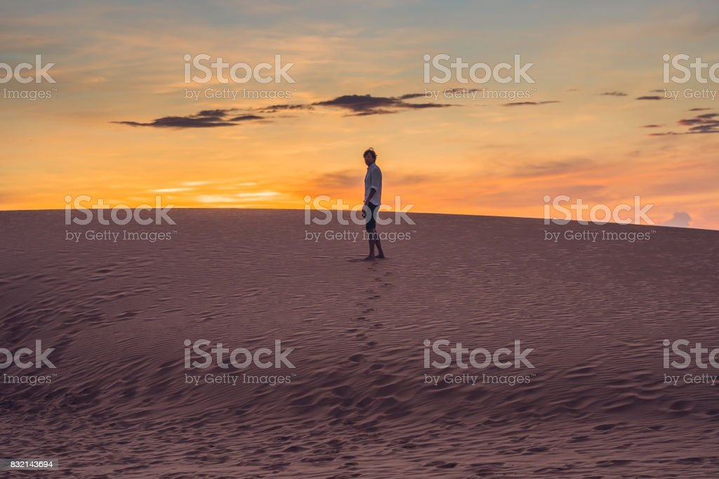 A man lost in the red desert in Vietnam, Mui Ne stock photo