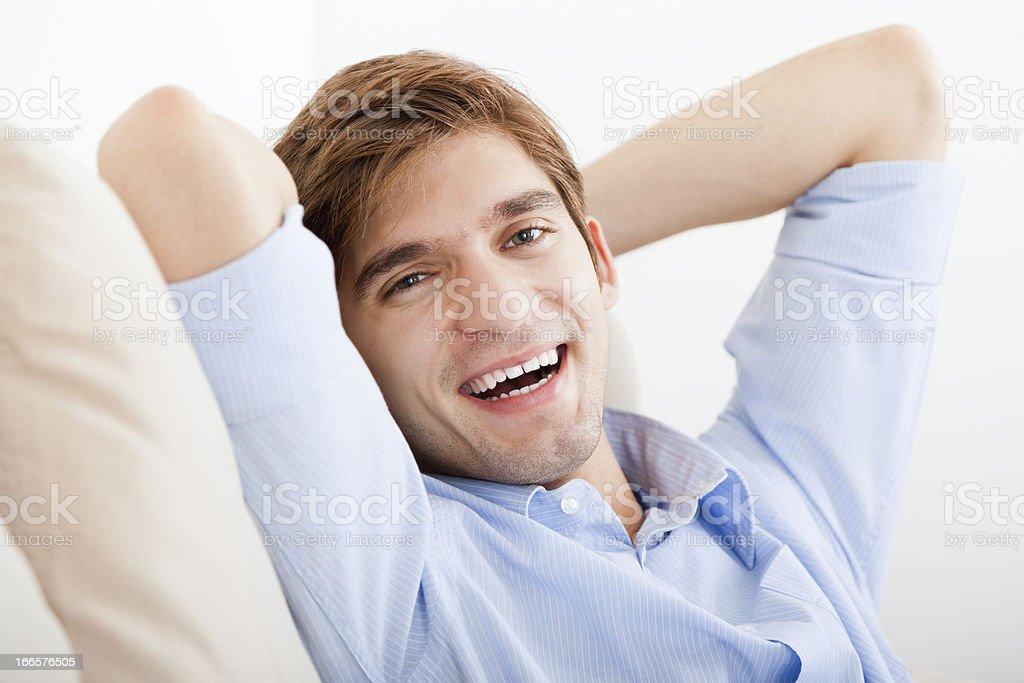 Man lying down on sofa royalty-free stock photo