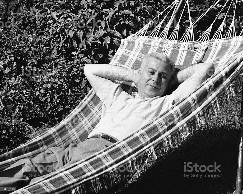 Man lying in hammock royalty-free stock photo