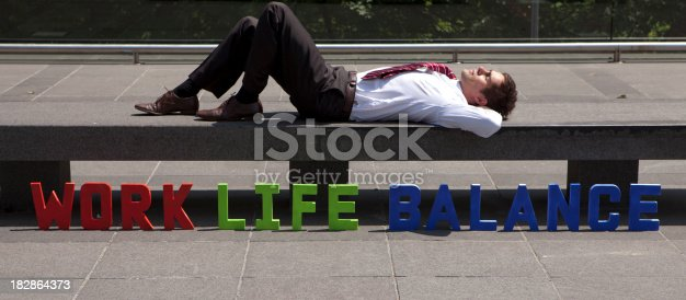 istock Man lying next to the letters - Work life balance 182864373