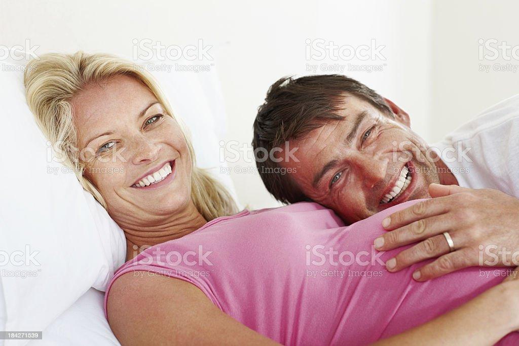 Man lying on pregnant woman's tummy royalty-free stock photo