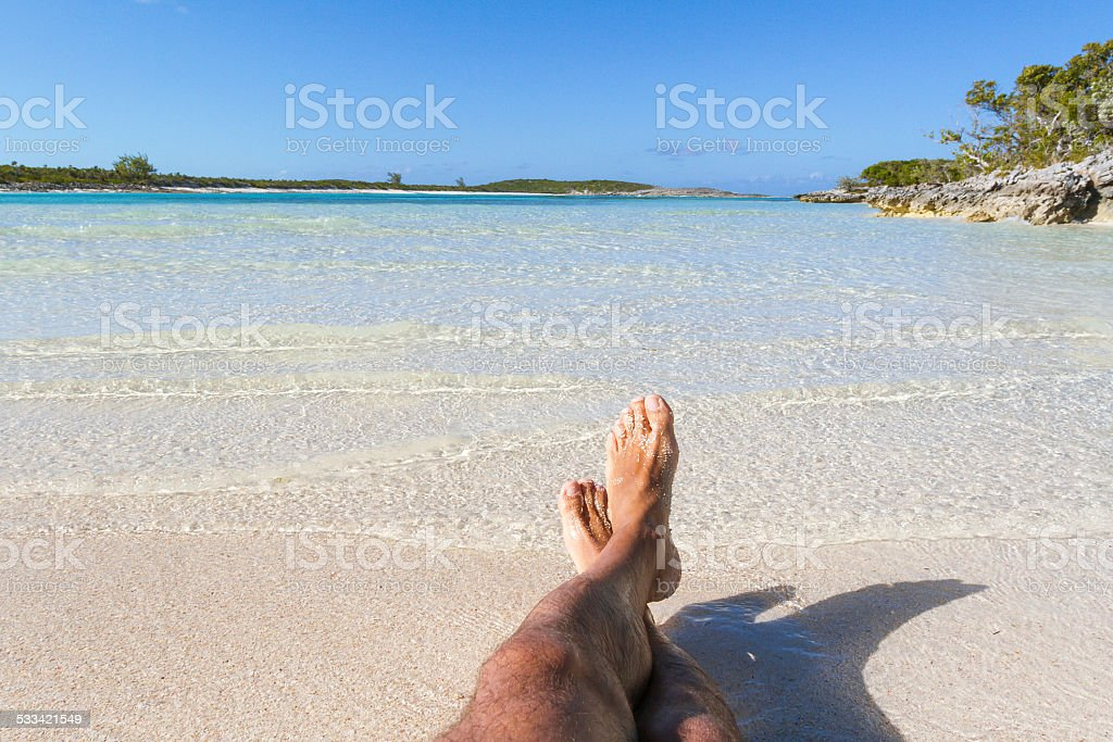 Man Lying on the beach stock photo