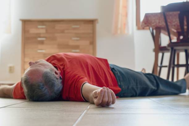 Man lying on the floor at home, epilepsy, unconsciousness, faint, stroke, accident  or other health problem stock photo