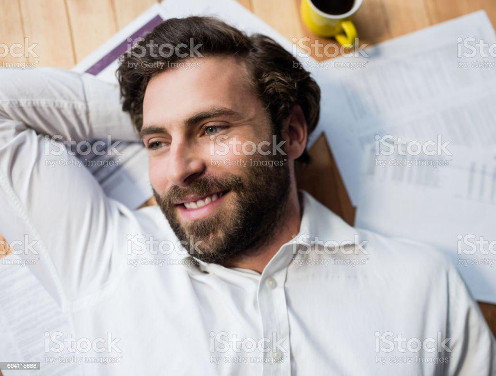 Man lying on the floor foto stock royalty-free