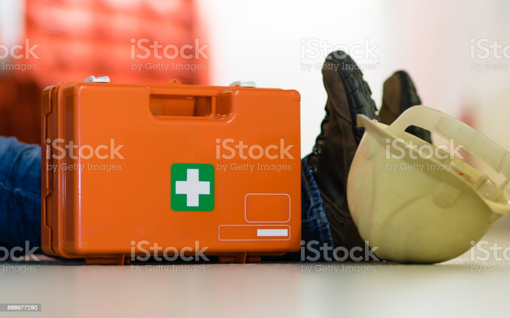 Man lying on the ground after a work accident stock photo