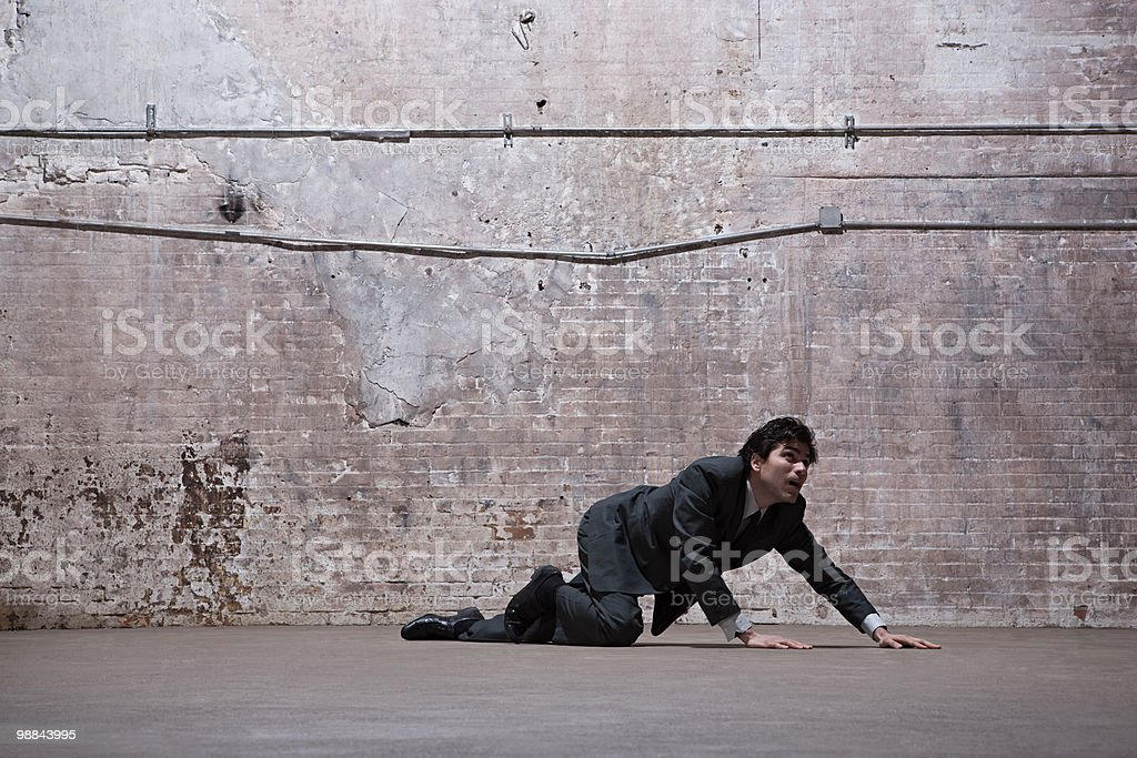 Man lying on warehouse floor 免版稅 stock photo