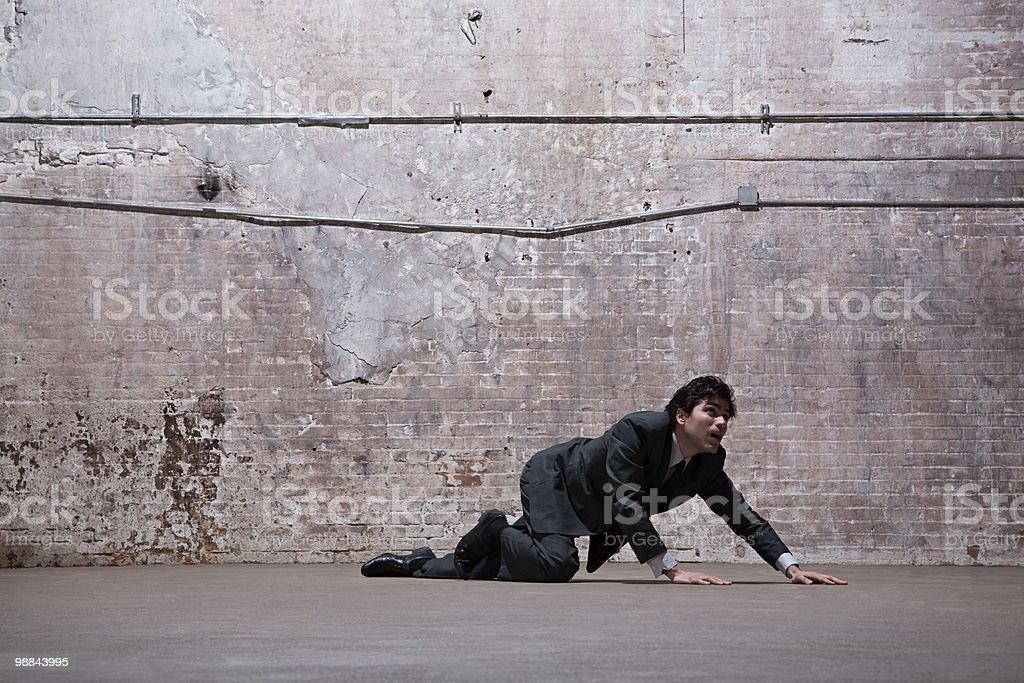 Man lying on warehouse floor stock photo