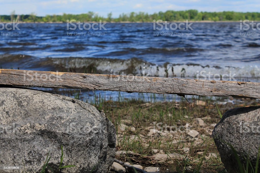 Man Made Bench In Front of Bay stock photo