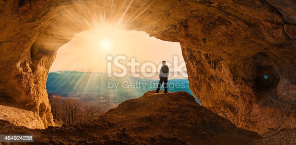 beautiful  man  mainsail  and cave mountains background