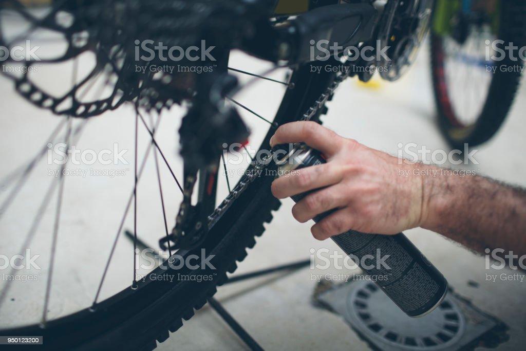 Man Maintenance His Bicycle stock photo