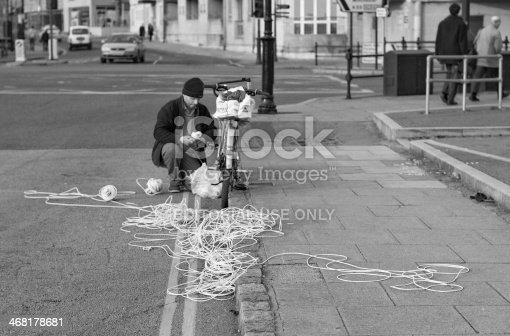 Southampton, England - March 28, 2007: a man seems to have lost on the street some sort of cables. The scene was photographed near the ferry terminal (Town Quay).
