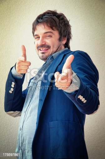 istock Man Makes Fingers Gun Gesture 175597861