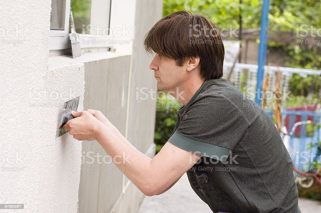 man makes renovation outdoor royalty-free stock photo