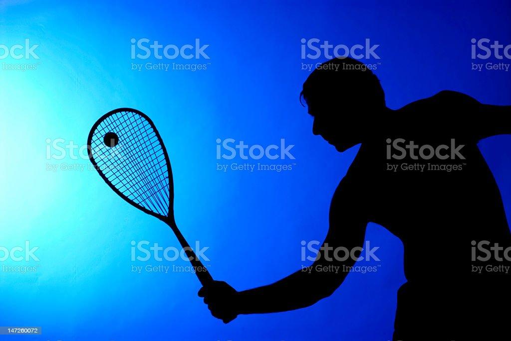 Man making a big swing in tennis game stock photo