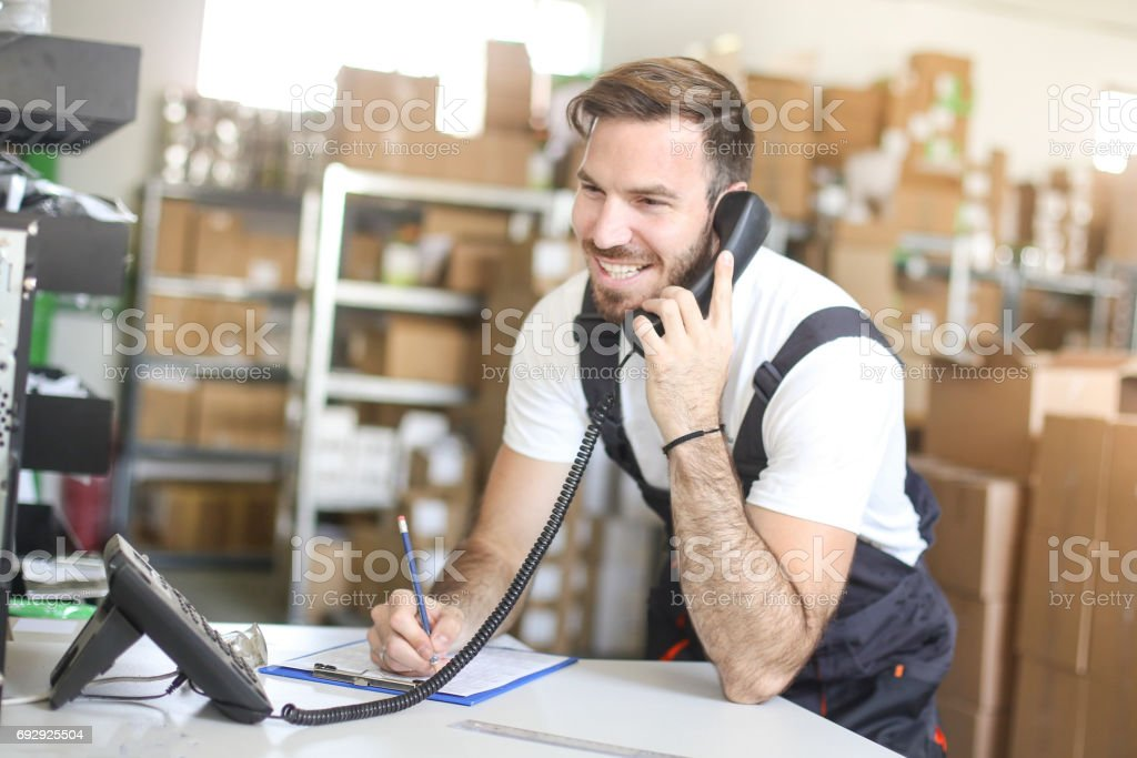 Man making a delivery list stock photo