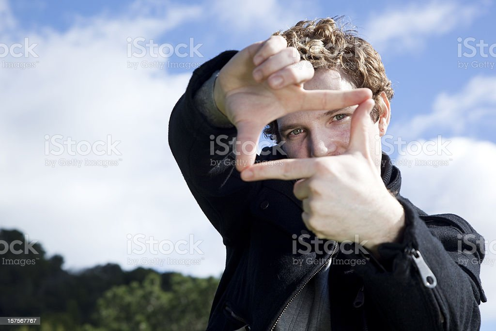 man making a frame with his hands royalty-free stock photo