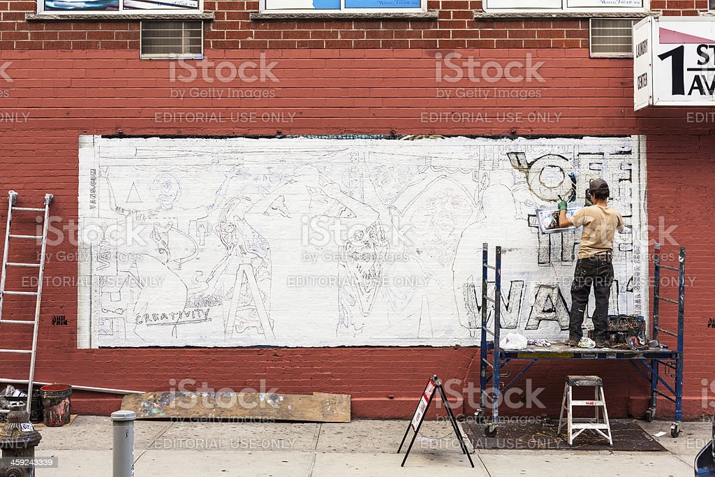 Man making a Graffiti on the Wall stock photo