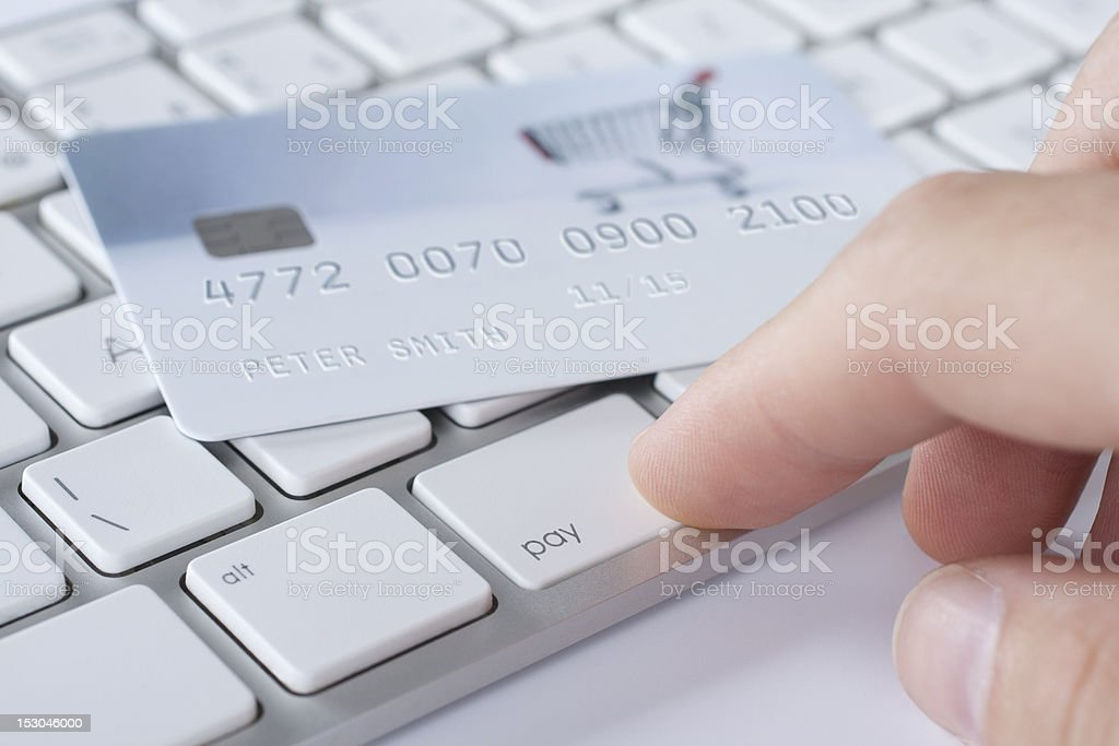 Man making an electronic online payment with credit card stock photo