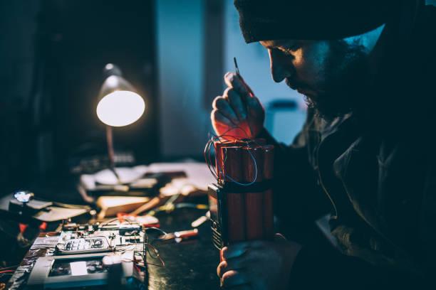 Man making bomb Man making time bomb at night terrorism stock pictures, royalty-free photos & images