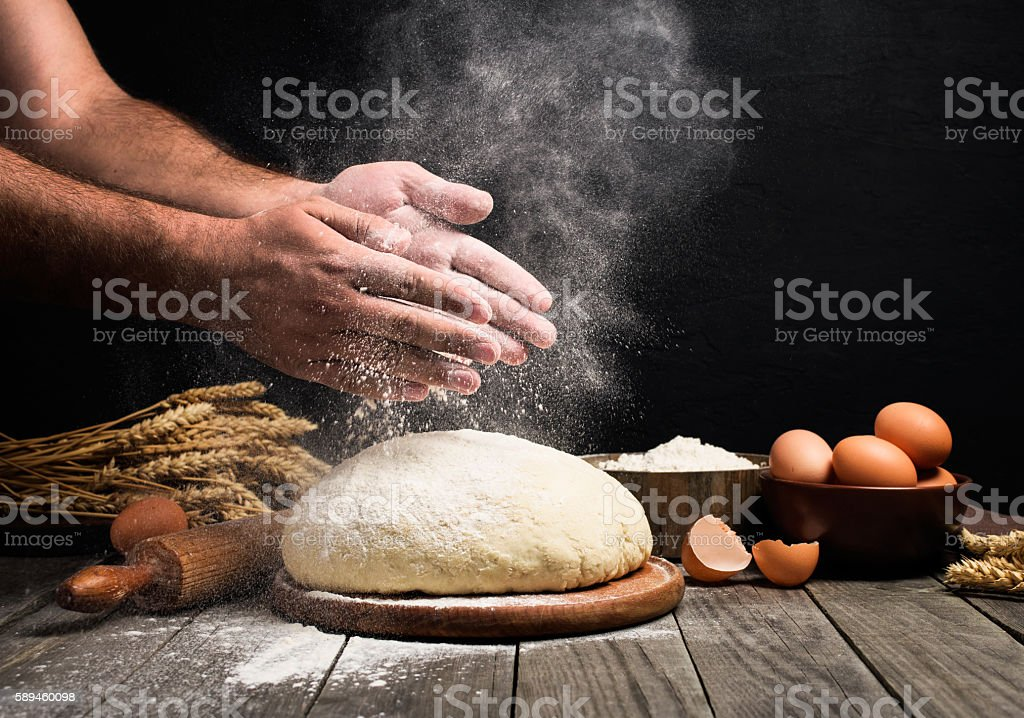 Man Making bread stock photo