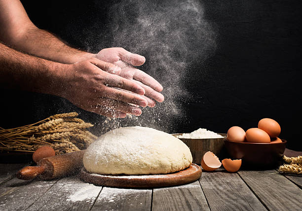 man making bread - bakeries stock photos and pictures