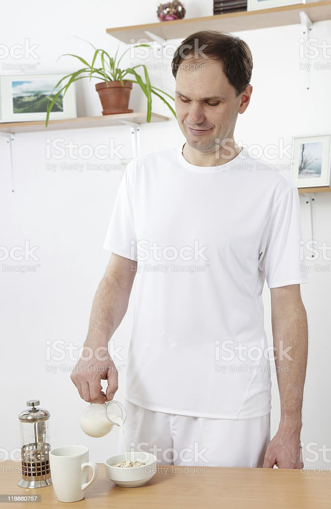 Man making breakfast royalty-free stock photo