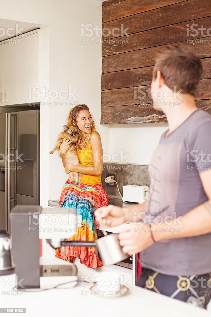 Man making coffee for his girlfriend stock photo