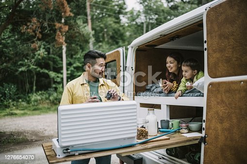 istock Man making coffee on camping stove 1276654070