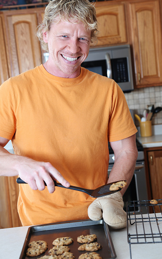 Man Making Cookies Stock Photo - Download Image Now