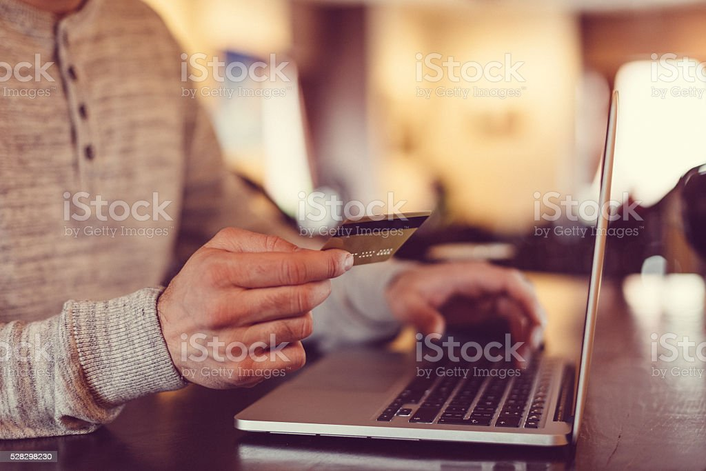 Man making credit card purchase online stock photo