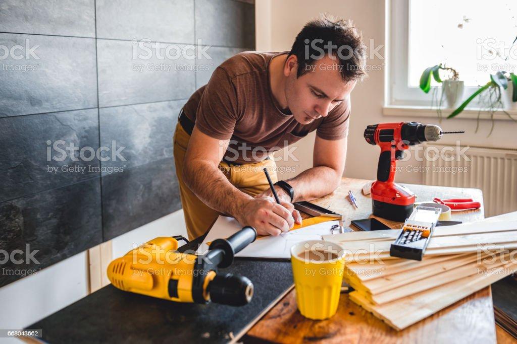 Man making draft plan using pencil stock photo