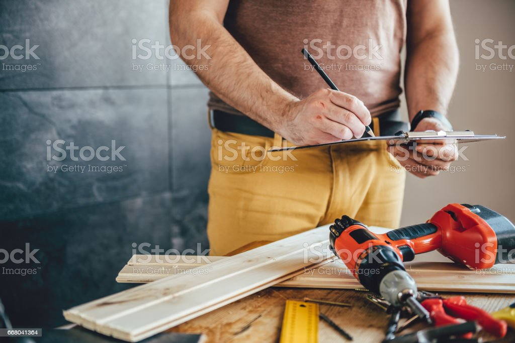 Man making draft plan with pencil on the table stock photo