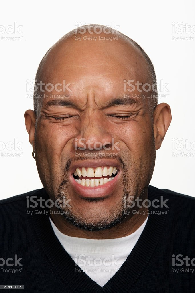 Man making face, close-up stock photo