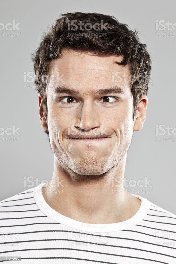 Man making face stock photo