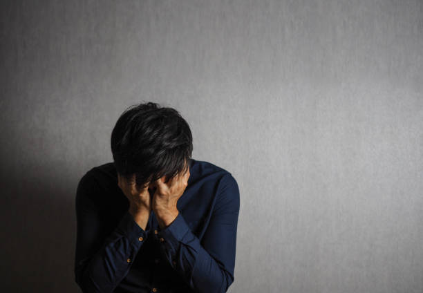 Man making facepalm gesture, sad and depression gesture stock photo