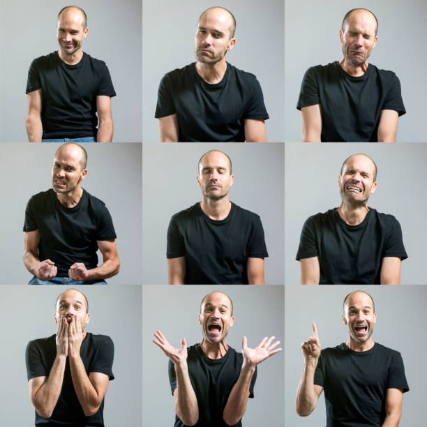 man making faces stock photo
