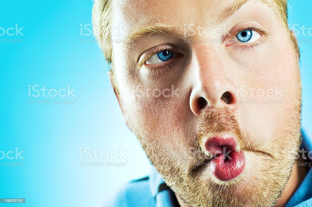 Man Making Fish Mouth with Lips royalty-free stock photo