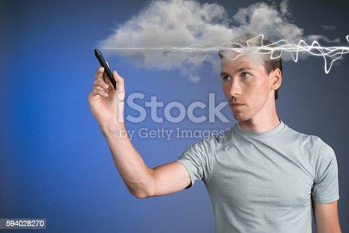 1152920014 istock photo Man making magic effect - flash lightning. The concept of 594028270