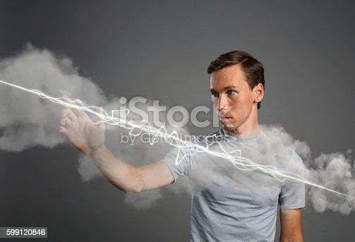 1152920014 istock photo Man making magic effect - flash lightning. The concept of 599120846