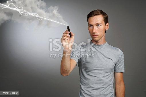 1152920014 istock photo Man making magic effect - flash lightning. The concept of 599121038