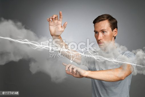 1152920014 istock photo Man making magic effect - flash lightning. The concept of 611774148