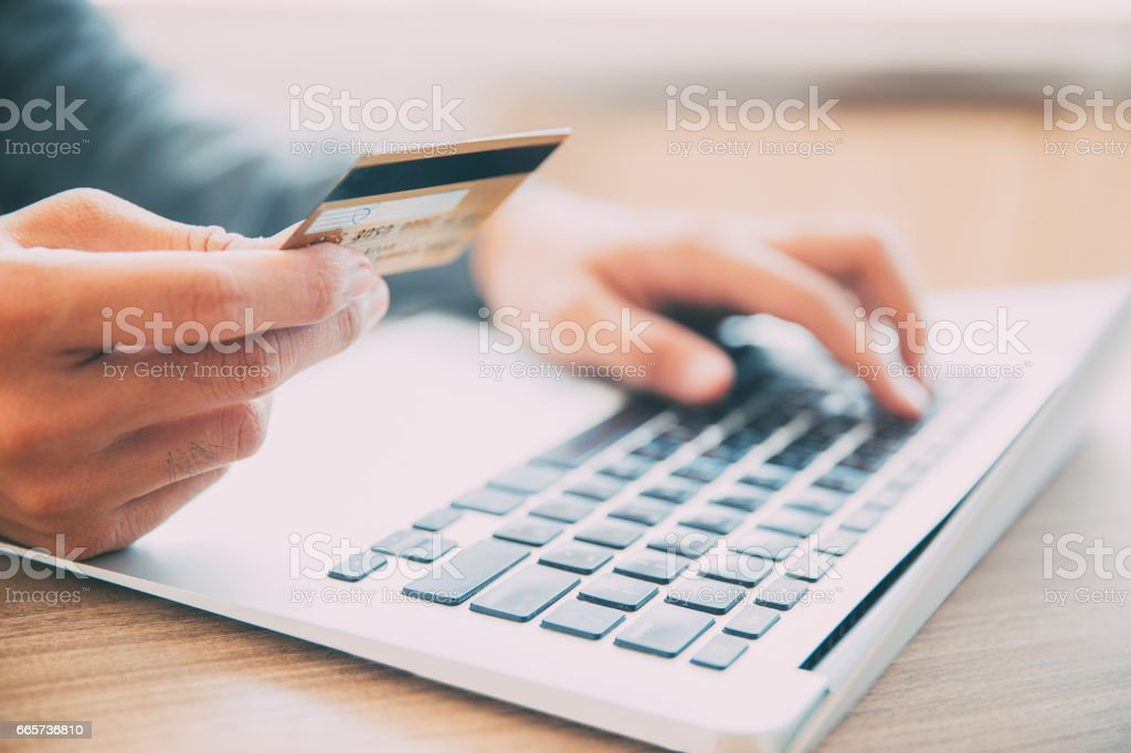Man making online purchase with credit card stock photo