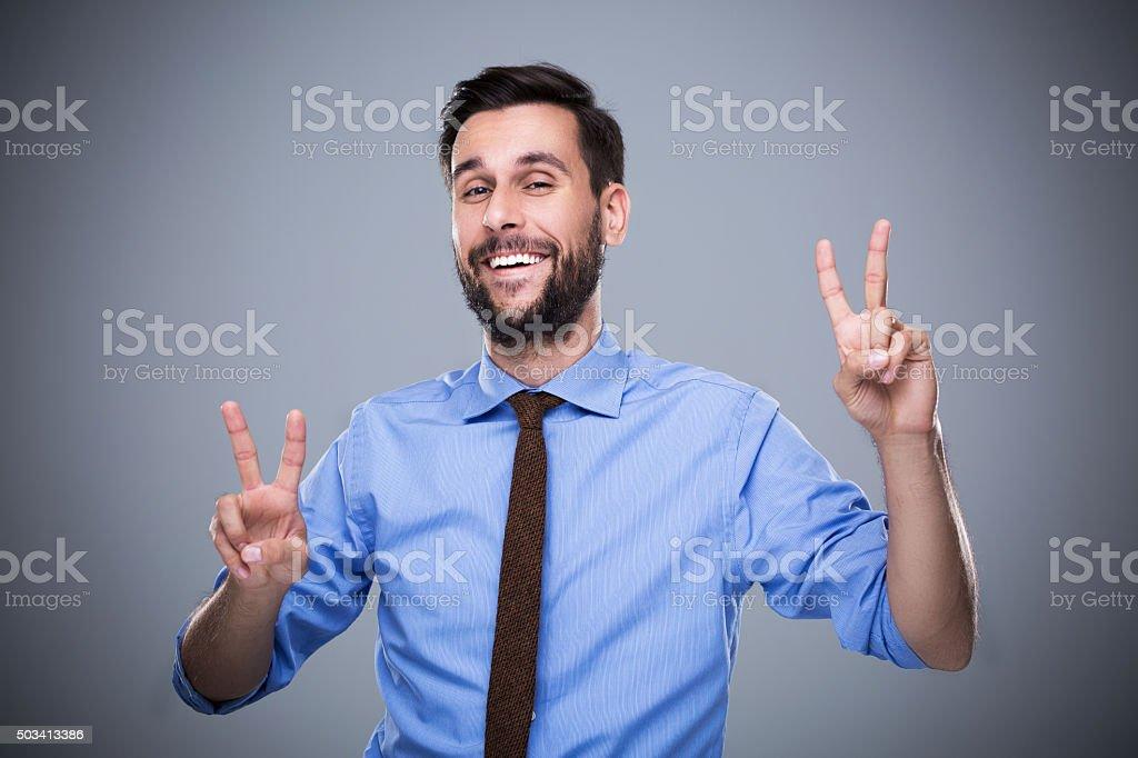 Man Making Peace Sign stock photo