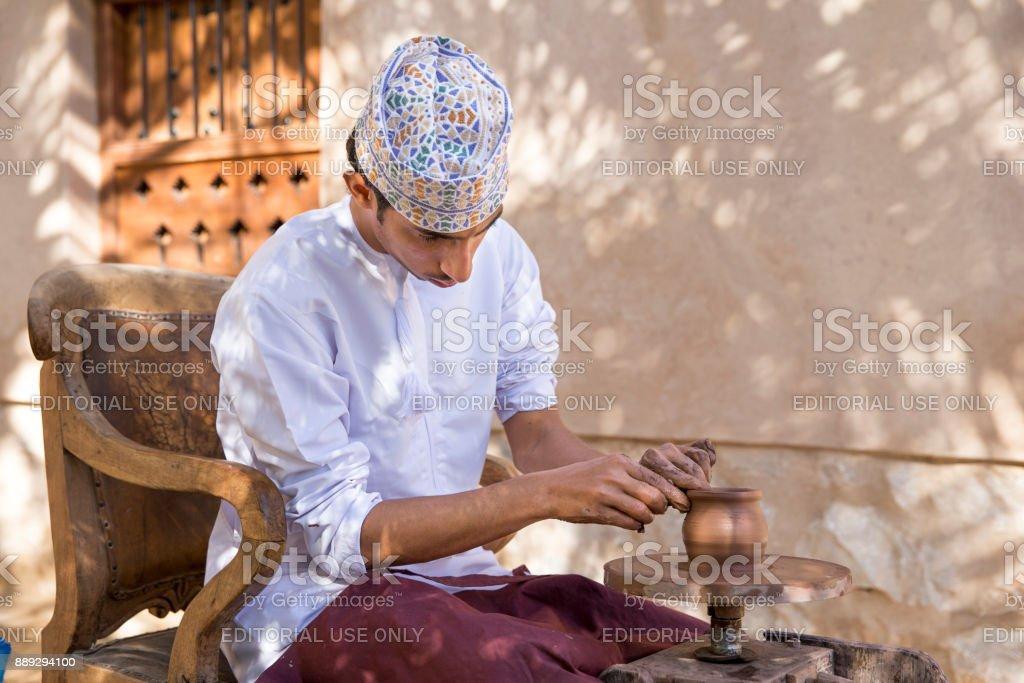 man making pottery stock photo