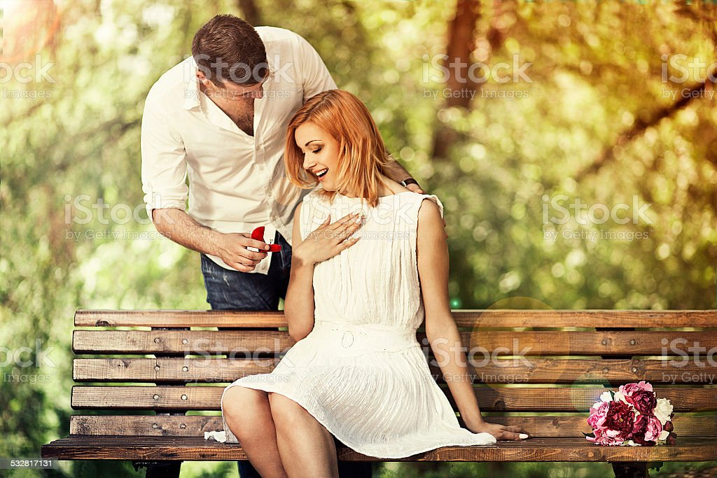 Man making propose to his girlfriend stock photo