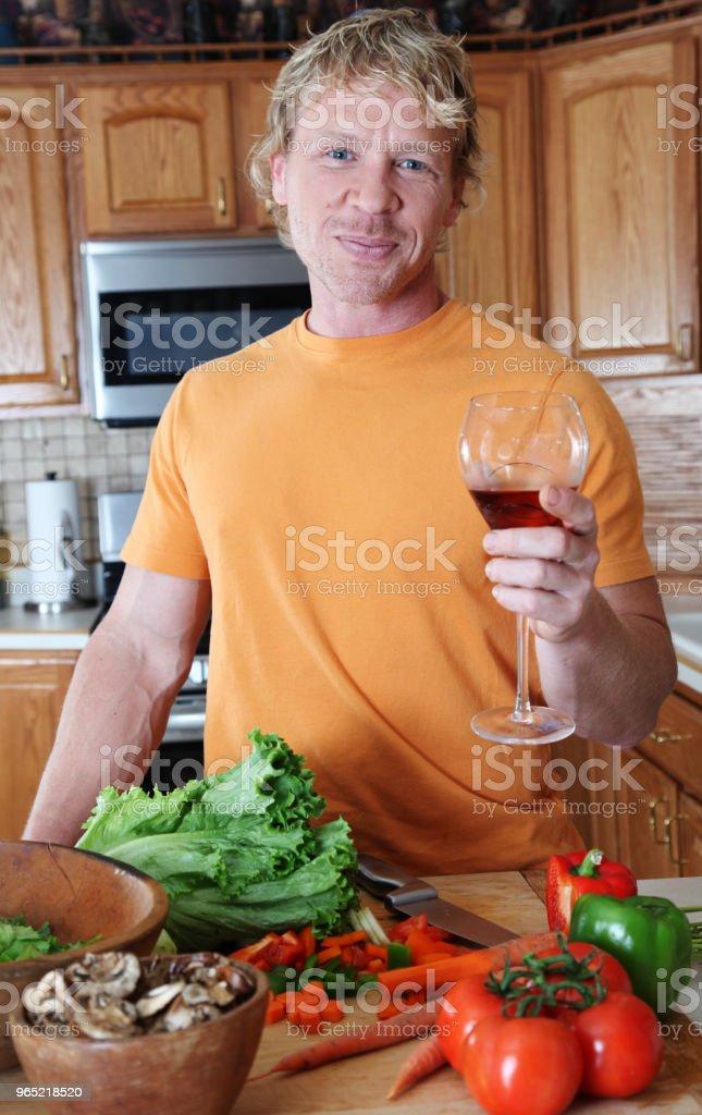 man making salad royalty-free stock photo