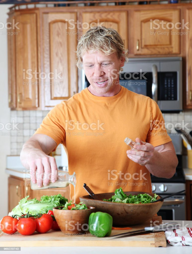 Man making salad royalty-free stock photo