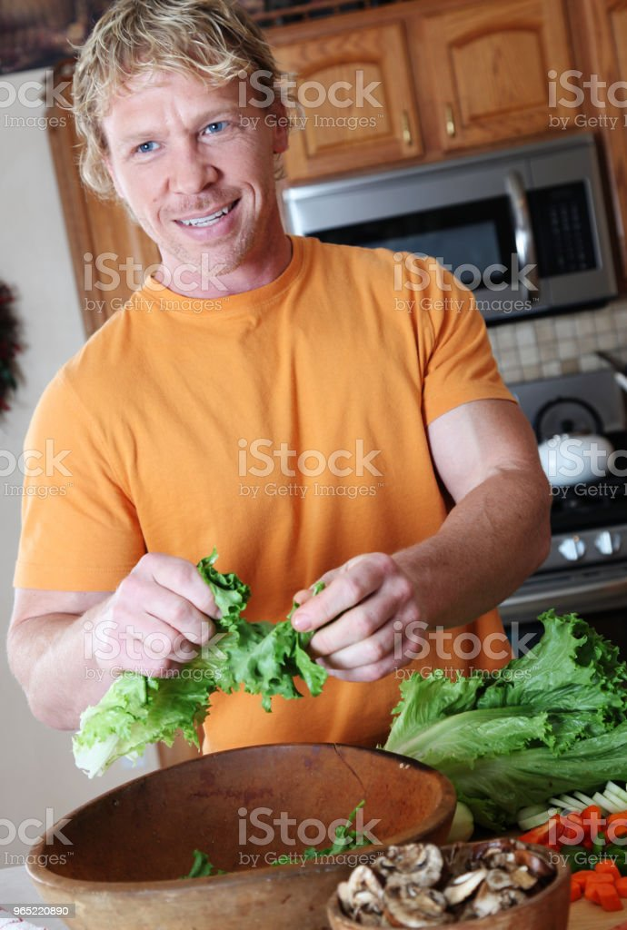 man making salad zbiór zdjęć royalty-free