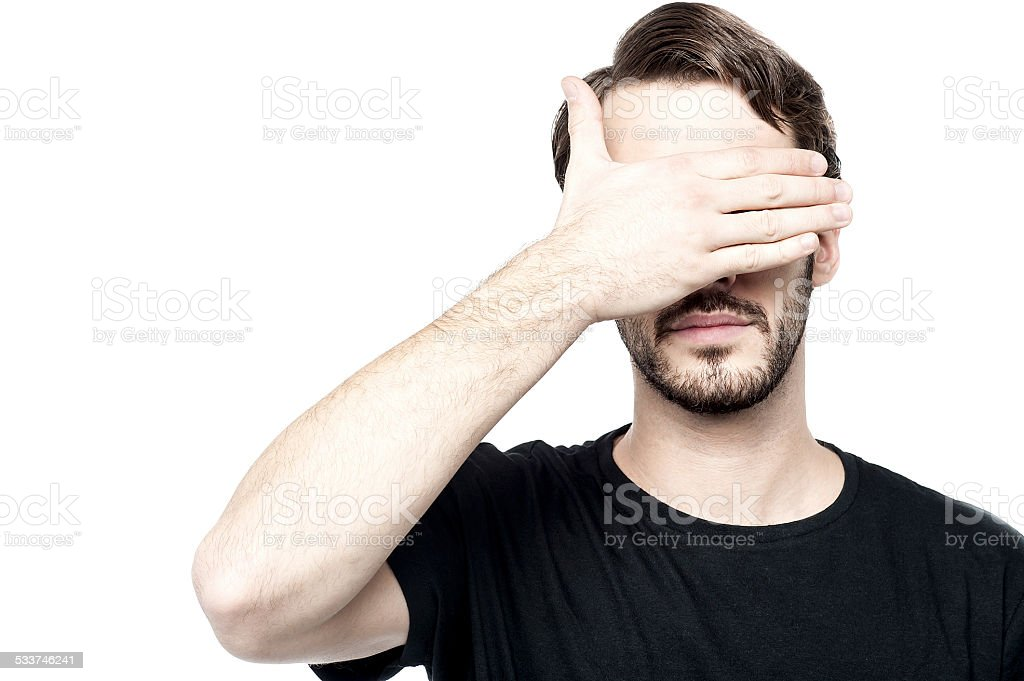 Man making see no evil gesture stock photo
